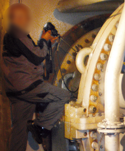 Gas turbine being inspected for damage by a boroscope (endoscope)